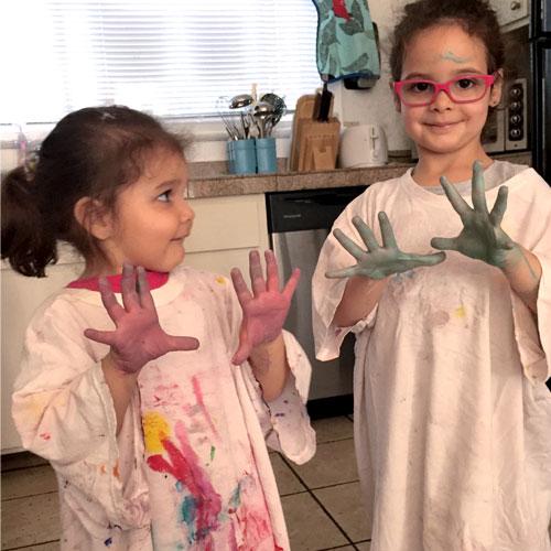 sisters-paint-hands