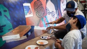 Local artists in the Canal district of San Rafael, California, collaborate with DrawBridge youth
